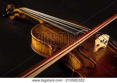 close up of a violin and bow