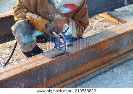 Welding work welder welding metal material in heavy industry manufacturing video clip