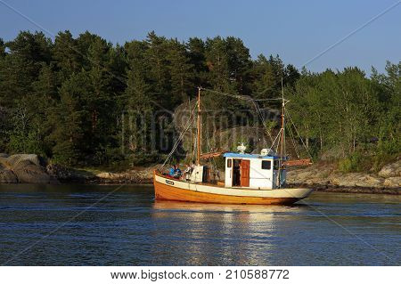 KRISTIANSAND ARCHIPELAGO, NORWAY ON JULY 01. View from the shore of boating people on the North Sea on July 01, 2009 in Kristiansand archipelago. Unidentified people. Editorial use.