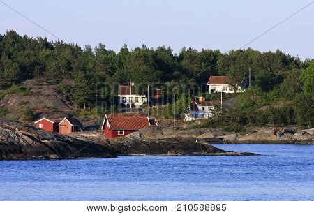 KRISTIANSAND ARCHIPELAGO, NORWAY ON JULY 02. View of the Norwegian archipelago in evening lit, islands and summer houses on July 02, 2009 in Kristiansand, Norway. Editorial use.