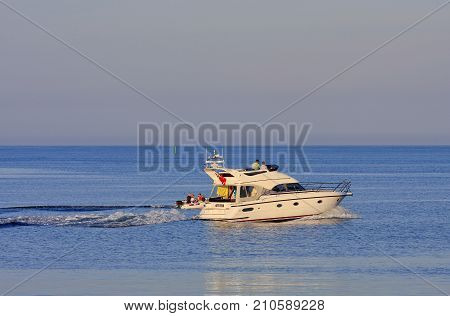 SØRLANDET, NORWAY ON JULY 02. View of two motorboats at sea on July 02, 2009 in the North Sea, Norway. Unidentified people on board. Sunny evening at sea. Editorial use.