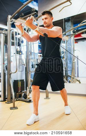 Power muscular smiling man gym sport concept. Lifestyle of athlete. Strength of will.
