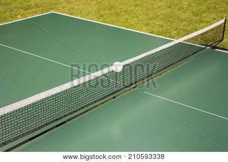 Table tennis, ping-pong table and the white ball on a green table. Sport