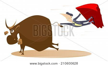 Bullfighter and a bull isolated. Bullfighter catches a running bull by tail