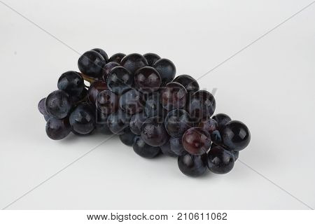 black grapes, black grapes  isolated on white. Full depth of field.