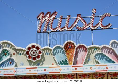 music sign on the top of a carnival ride at the seattle center. poster
