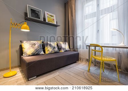 Couch, Yellow Lamp And Chair