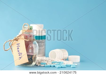 Glass Jars With Coins And 'health' Text
