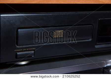 old hi-fi cd player front with cd tray