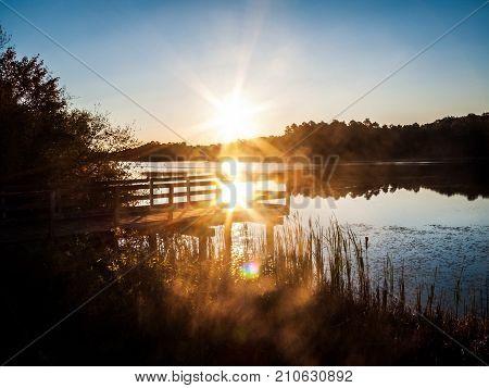 Bright sunlight over Prospertown Lake in Jackson New Jersey.