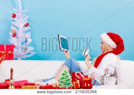 Woman In Santa Hat Holding Tablet And Credit Card