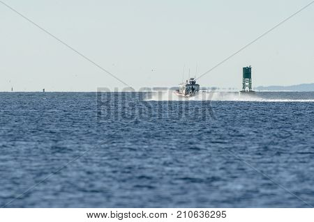 Fairhaven Massachusetts USA - October 20 2017: Fairhaven Fire Department patrol boat heading toward Buzzards Bay