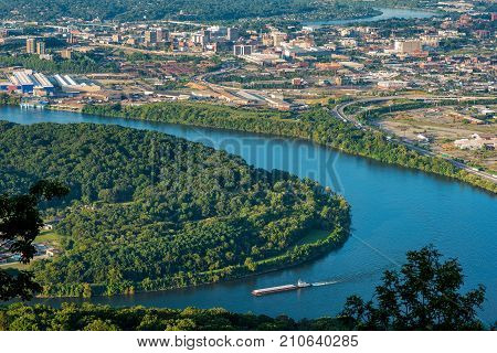 Aerial view of Chattanooga and the Tennessee River with river barge in the foreground