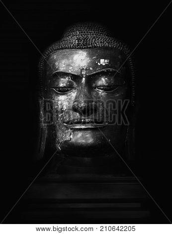 Budha head in black and white .