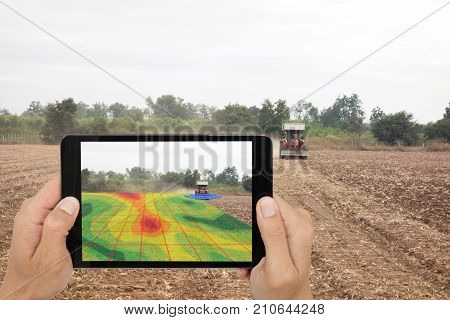 smart agriculture concept farmer use tablet read infrared in tractor with high definition soil mapping while plantingconduct deep soil scan during a tillage pass include organic ecomNitrogenseed