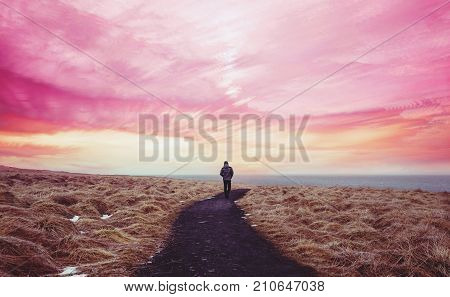Colorful landscaped, a man walking alone on the way forward with colorful sky