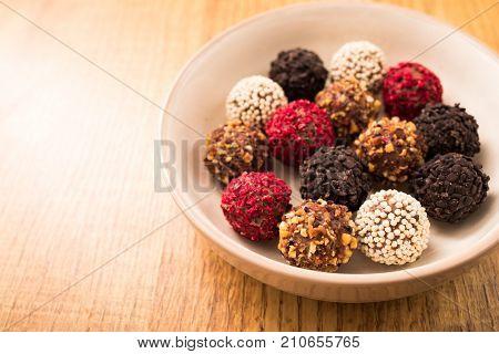 homemade chocolate pralines. homemade chocolate truffle on wooden table