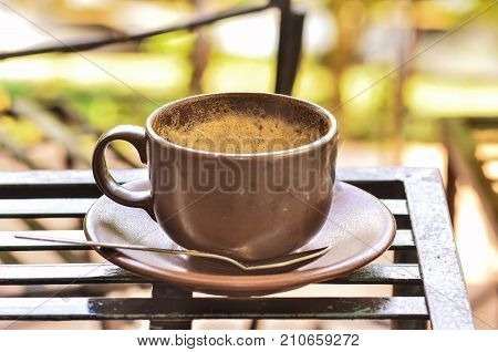 Coffee Cup With Froth On Table In Morning Day