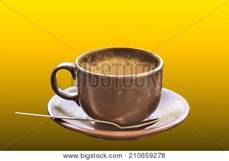Coffee Cup With Froth On Yellow Background