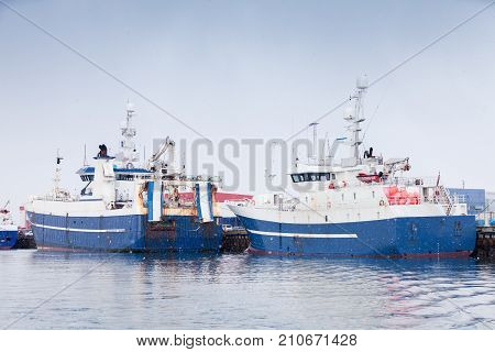 Industrial Fishing Ships. Blue White Trawlers