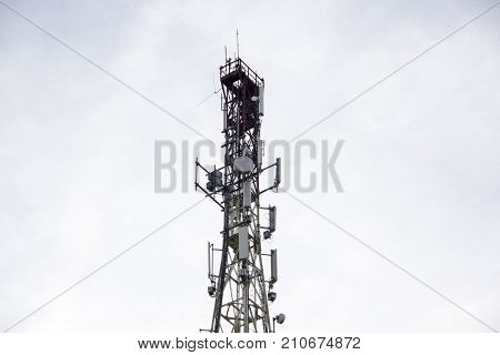 Antenna and cell phone towers on a mountaintop on a clear day