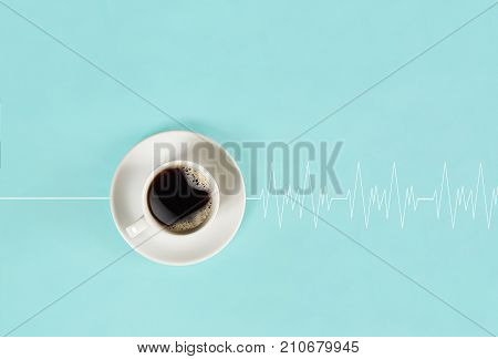 Invigorating coffee in the morning awakens the head and causes the heart to beat. Top view on blue background. Still life. Mock up. Flat lay
