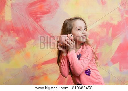 Sale and black friday shopping. Crisis and loan. Bankruptcy and handout. Child with happy face save money for future. Girl hold moneybox or piggy bank for savings.