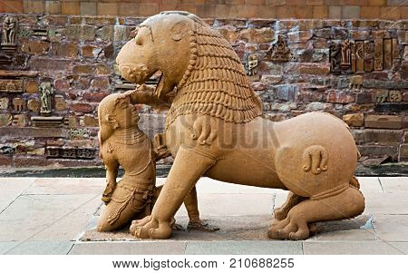 Sculpture of lion and woman in group the famous temples of Khajuraho. This is a large group of medieval hindu and jain temples famous for their erotic sculptures. Situated in Khajuraho Madhya Pradesh India. Unesco world heritage site.