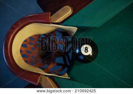 Billiard ball in a pool table near pocket. focus on the eight ball
