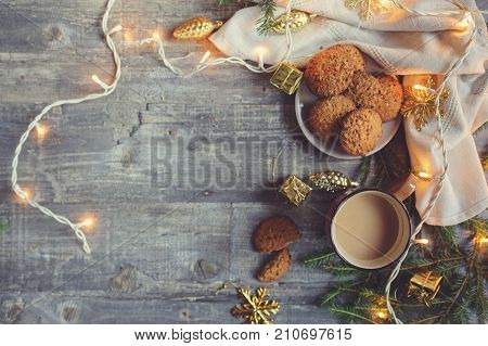 top view of cozy Christmas and winter setting with homemade cookies coffee and New Year decorations with empty space