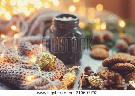Cozy winter and Christmas setting with hot cocoa with marshmallows and homemade cookies. Warm and homely Danish hugge concept