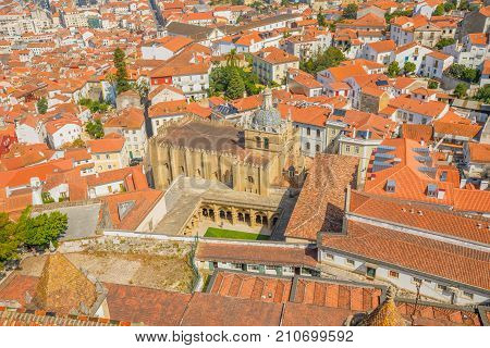 Coimbra panorama from top of bell Clock Tower. Old Coimbra Cathedral with dome and cloister. Se Velha de Coimbra, is one of most important romanesque buildings in Portugal and landmark in Coimbra.