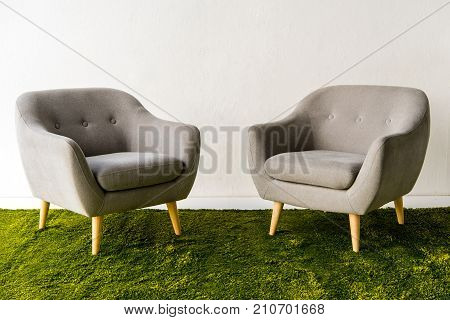 Armchairs On Green Carpet