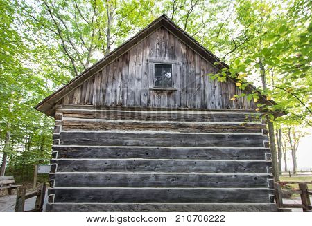 Exterior Wall Of Historical Pioneer Log Cabin.  Pioneer log cabin on display in a northern Michigan county park. This is a historical display in a public park and not a privately owned residence.