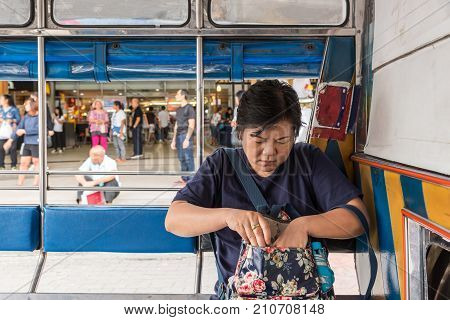 Asia Women On A Minibus Car For A Passenger Travel