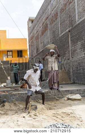 PONDICHERY PUDUCHERY INDIA - SEPTEMBER 03 2017. Unidentified indian workers works at the construction house site. Concept of hard works about buldings.