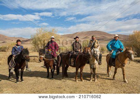 BAYAN-OLGII, MONGOLIA - SEP 28, 2017: Kazakh Berkutchi (Eagle hunters) on horseback. In Bayan-Olgii Province is populated to 88,7% by Kazakhs.