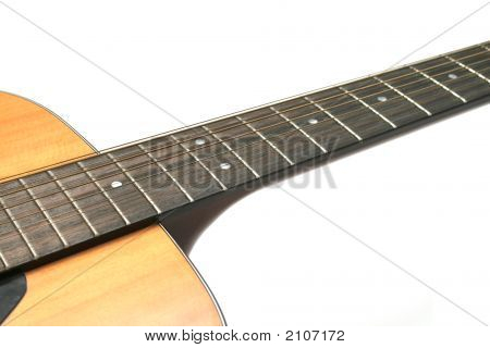 12 String Guitar Closeup Of Neck And  Body Against A White Background