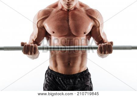 Cropped photo of muscular sweaty sports man in black shorts exercising with barbell, isolated on white background