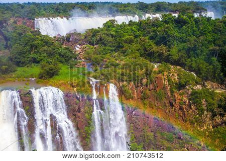 Complex of the most abounding in water Iguazu Falls in the world. Border of Argentina, Brazil and Paraguay. Concept of active and extreme tourism
