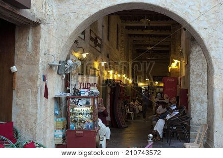 SOUQ WAQIF, DOHA, QATAR - OCTOBER 23, 2017: The entrance to the arcade area of Souq Waqif in Qatar, Arabia.