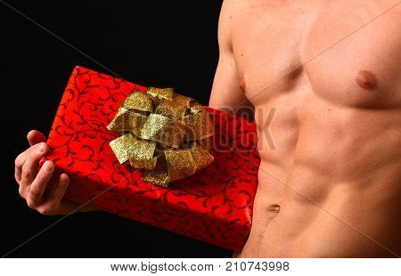 Athletes Body In Close Up, Hand Holding Red Gift Box