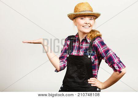 Woman Wearing Sun Hat, Showing Copyspace On Hand