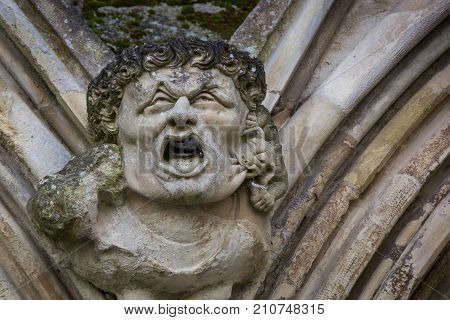 Horrific gargoyle on a historic cathedral in England