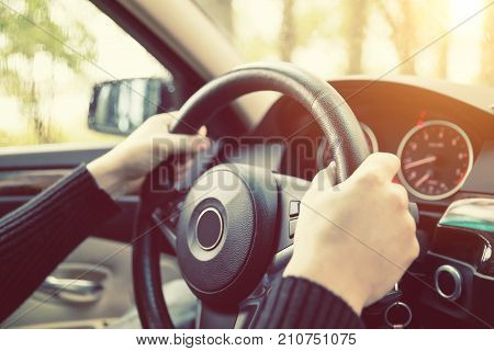 Close Up Of Man Hands Driving A Car