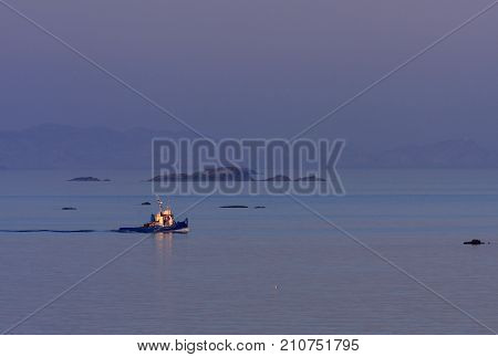 KRISTIANSAND ARCHIPELAGO, NORWAY ON JULY 03. View of a tug, towboat at sea on July 03, 2009 in Kristiansand Archipelago, Norway. Islands and islets. Editorial use.