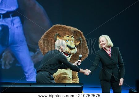 LAS VEGAS NV - JUNE 5 2012: HP CEO Meg Whitman and DreamWorks CEO Jeffrey Katzenberg deliver an address to HP Discover 2012 conference with cartoon character lion on June 5 2012 in Las Vegas NV