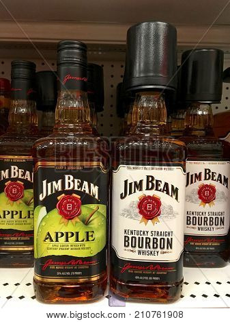 Alameda CA - October 05 2017: Store shelf with bottles of Jim Beam Bourbon a brand of bourbon whiskey produced in Clermont Kentucky. It is one of the best selling brands of bourbon in the world.