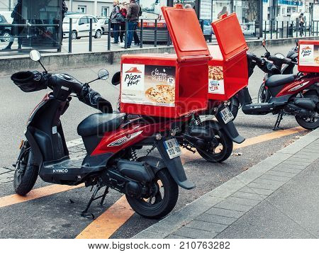 STRASBOURG FRANCE - DEC 2 2016: Pizza-Hut delivery motorcycles parked on the street waiting for the order and delivery to the client