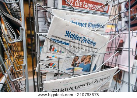 PARIS FRANCE - SEP 25 2017: latest German Kehler Zeitung newspaper with portrait of Angela Merkel after election in Germany for the Chancellor of Germany the head of the federal government
